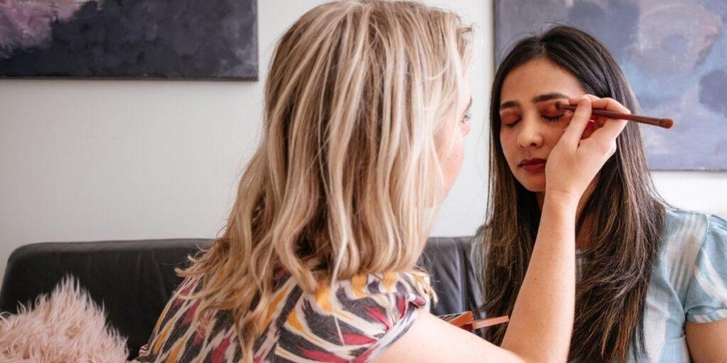 woman doing another woman's makeup